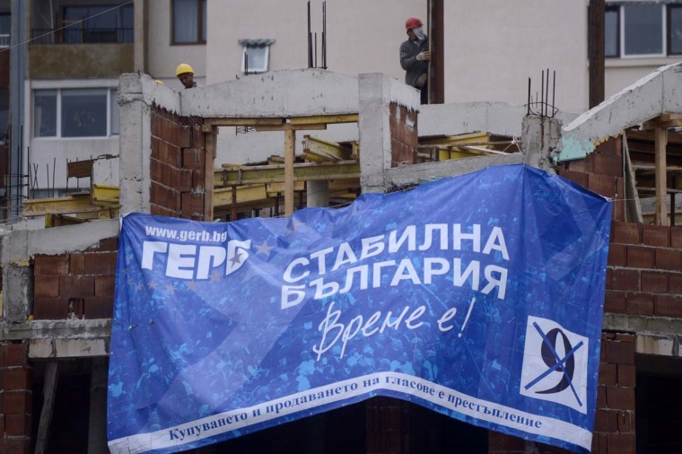 A Bulgarian conservative GERB party banner, reading: ''Stable Bulgaria'', is attached at the front of a construction site in Sofia on October 3. Bulgarians vote on October 5 to elect a new government after almost two years of political instability that has undermined voter trust and shaken the economy of the poorest EU country.  Ex-communist Bulgaria's second snap election in 17 months takes place in a country where the average monthly salary is stuck at 400 euros ($504) and where corruption and organized crime are rife.      || CREDIT: NIKOLAY DOYCHINOV - AFP/GETTY IMAGES