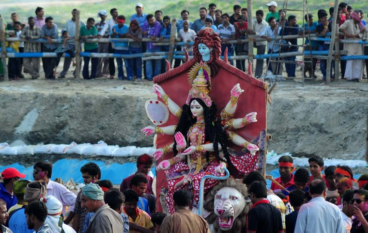 Hindu devotees carry an idol of goddess Durga to be immersed in a temporary pond near Sangam as part of the Durga Puja festival in Allahabad on October 3. Durga Puja commemorates the slaying of demon king Mahishasur by goddess Durga, marking the triumph of good over evil.  || CREDIT: SANJAY KANOJIA - AFP/GETTY IMAGES