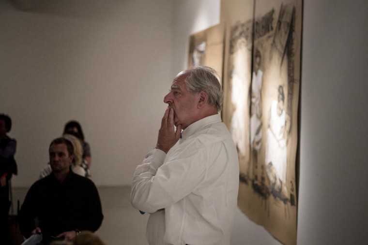 "South African artist and Kyoto Prize 2010 recipient William Kentridge poses in front of some of his drawings during a public appearance at an art gallery in Johannesburg on October 3. Kentridge, 59, introduced today a new body of work consisting of drawings of landscapes from the East Rand. This series is collected in a book called ""Accounts and Drawings from the Underground"" will be presented in Johannesburg on November 15.  