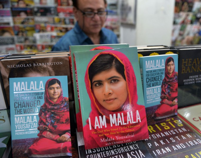 """Autobiographies of Malala Yousafzai are displayed at a bookstore in Islamabad on October 10, 2014. Malala Yousafzai was hailed as the """"pride of Pakistan"""" by Prime Minister Nawaz Sharif for winning the Nobel Peace Prize, as a former fellow pupil said the award was a victory for every girl in the country. Political leaders and activists alike rallied around Malala, the youngest ever Nobel laureate, expressing their support for the education campaigner who moved to Great Britain after being shot in the head by Taliban militants two years ago. (Qureshia Amir/AFP/Getty Images)"""