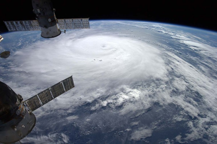 This NASA image of Hurricane Gonzalo was taken from the International Space Station by European Space Agency astronaut Alexander Gerst on October 16.  The resort island chain of Bermuda braced October 17, 2014 for a hit from Hurricane Gonzalo, forecast to produce flooding, strong winds and a life-threatening storm surge. The capital, Hamilton, was eerily quiet as people retreated to the safety of their homes. Schools, businesses, grocery stores and government offices all closed early Thursday, and many people boarded up the windows of their homes and placed sandbags outside in preparation. As of early Friday, Gonzalo's winds were whirling at 125 miles (200 kilometers) per hour, with even stronger gusts, the US National Hurricane Center said. Gonzalo has already killed one person in the Caribbean and triggered a hurricane warning for the British overseas territory, which is home to around 60,000 people.  AFP PHOTO  - NASA/ALEXANDER GERST - HANDOUT