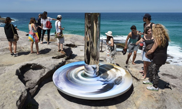"A sculpture by artist Linda Matthews of Australia titled ""Coastal totem"" overlooks Sydney's coastline as artists from 16 countries prepare their works for the upcoming Sculpture by the Sea exhibition, on October 23, 2014. (William West/AFP/Getty Images)"