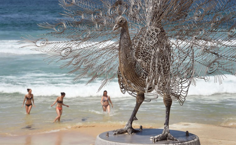"A sculpture by artist Byeong-Doo Moon of South Korea titled ""Our memory in your place"" overlooks Sydney's Tamarama Beach as artists from 16 countries prepare their works for the upcoming Sculpture by the Sea exhibition, on October 23, 2014. (William West/AFP/Getty Images)"