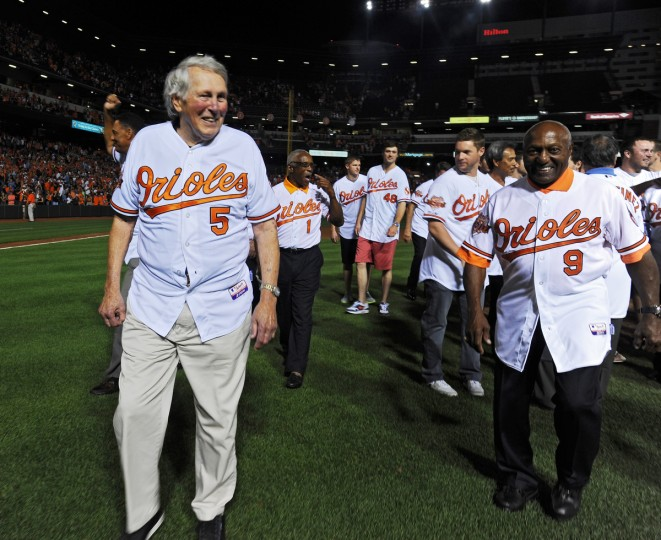 Orioles Hall of Famers Brook Robinson (5), Don Buford (9) and others walk off the field after a post-game ceremony In August 2014 to celebrate the Orioles' 60th anniversary. (Kenneth K. Lam/Baltimore Sun)