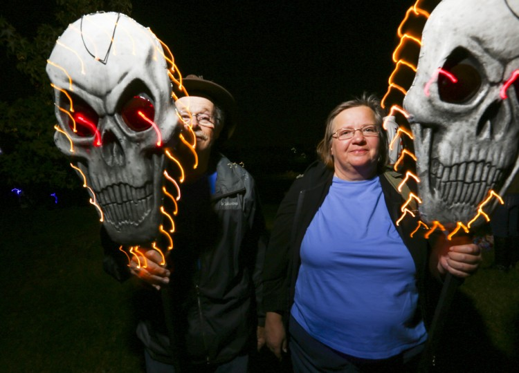 Cecilia and Bill Diggs hide behind skeleton masks at the annual Halloween Lantern Parade at Patterson Park this past weekend. (Kaitlin Newman/Baltimore Sun)