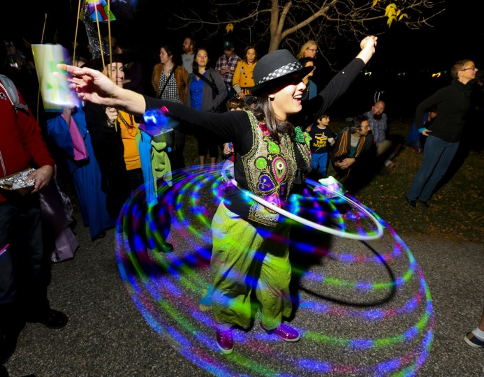 Mara Low, 31, hoops at the annual Halloween Lantern Parade at Patterson Park this past weekend. (Kaitlin Newman/Baltimore Sun)