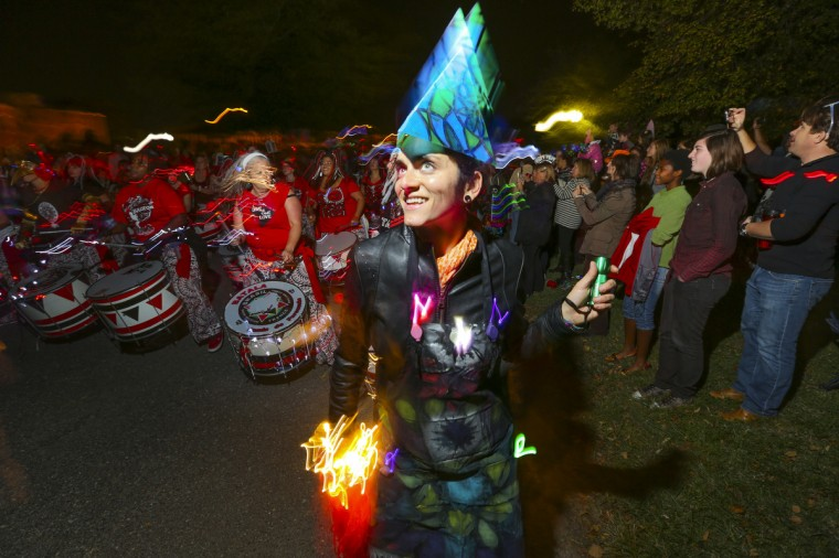 Shannon Townsend, 31, dances in front of the drummers at the annual Halloween Lantern Parade at Patterson Park this past weekend. (Kaitlin Newman/Baltimore Sun)