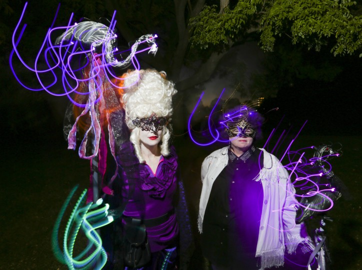 Jill Windburn, left, and Paula Kopp, right, wear beautiful masks at the annual Halloween Lantern Parade at Patterson Park this past weekend. (Kaitlin Newman/Baltimore Sun)