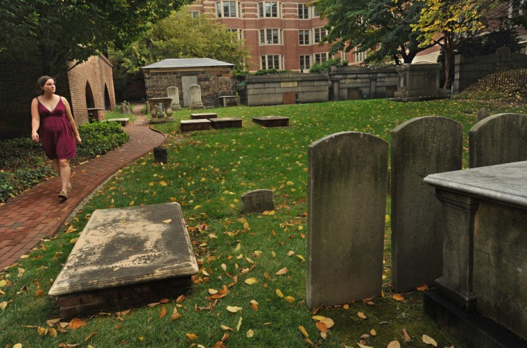 Ashley Channels of Washington, D.C., left, visits the Westminster Burying Ground. This is the south side of the cemetery. Amy Davis / Baltimore Sun
