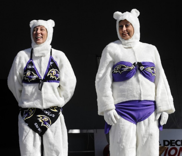 Monique Cartier, left, and her mother Shirley, of Bel Air, are members of the Marching Ravens Band's flag line. They dressed as bi-polar bears for the costume contest before the 1 o'clock plunge into the Chesapeake Bay during the 16th annual Maryland State Police Polar Bear plunge at Sandy Point State Park in January 2012. (Kenneth K. Lam/Baltimore Sun)