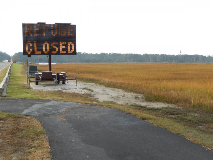 Refuge closed sign: Chincoteague National Wildlife Refuge was closed for most of the day on Wednesday as NASA and Orbital swept the area and shoreline for possible hazardous material following the Antares rocket explosion on Tuesday at the NASA Wallops Flight Facility on Wallops Island, Va. No hazardous material was found and the refuge was reopened at 3 p.m. on Wednesday. (Eduardo A. Encina, Baltimore Sun)