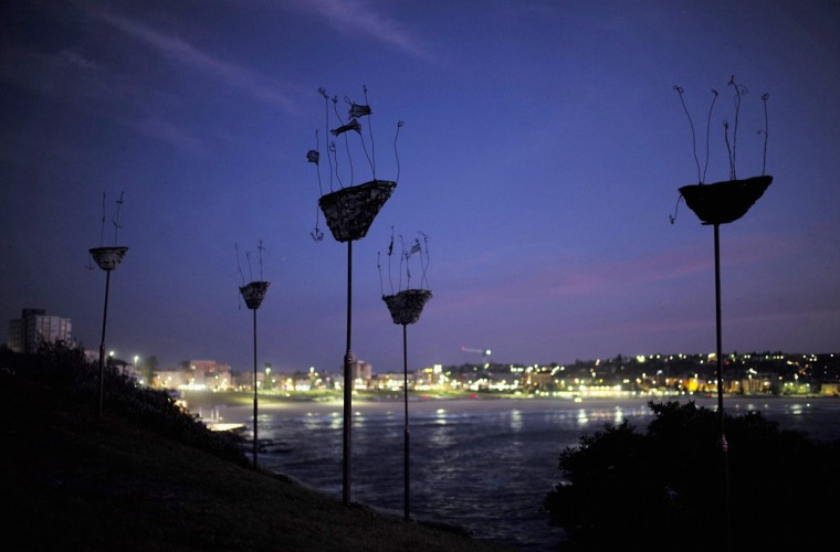 "A sculpture by Melissa McElhone titled 'Vessels of destiny' is shown before sunrise as part of the ""Sculpture by the Sea"" exhibition at Sydney's Bondi Beach on its opening day October 23, 2014. (Jason Reed/Reuters)"