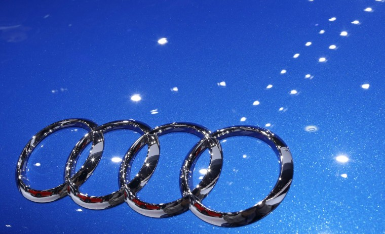 An Audi logo is seen on an Audi R8 LMX car displayed on media day at the Paris Mondial de l'Automobile, October 2, 2014. The Paris auto show opens its doors to the public from October 4 to October 19. Jacky Naegelen/Reuters photo
