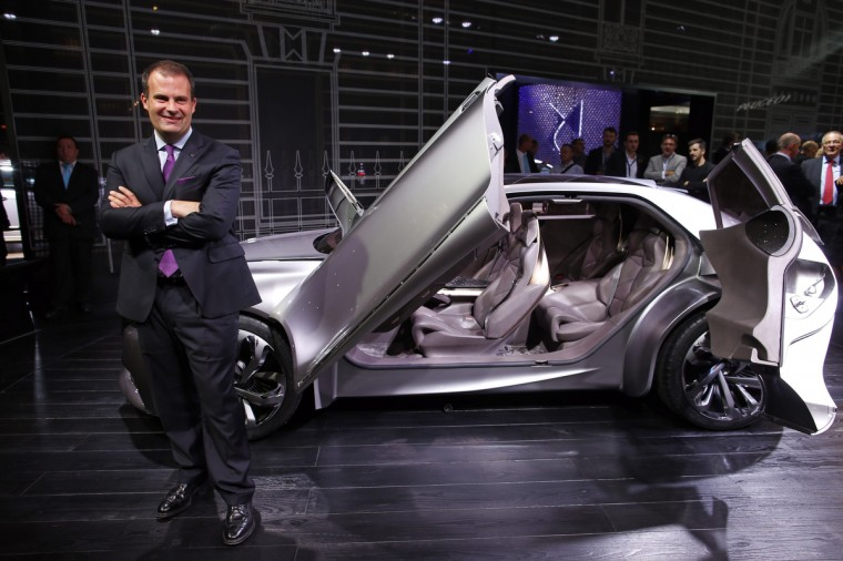 Yves Bonnefont, CEO of DS brand, poses next to the Divine DS concept car on media day at the Paris Mondial de l'Automobile, October 2, 2014. The Paris auto show opens its doors to the public from October 4 to October 19. Benoit Tessier/Reuters photo