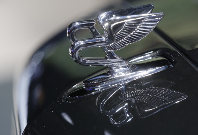 A Bentley enblem is seen on a Mulsanne Speed car displayed on media day at the Paris Mondial de l'Automobile, October 2, 2014. The Paris auto show opens its doors to the public from October 4 to October 19. Jacky Naegelen/Reuters photo
