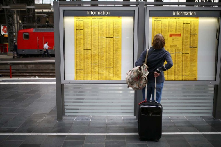 A passenger checks a train table at the main railway station in Frankfurt, October 17. German train drivers will stage a nationwide strike for the second time this week in a drawn-out dispute over pay and conditions with state-owned rail operator Deutsche Bahn, union GDL said on Friday.    || PHOTO CREDIT: RALPH ORLOWSKI  - REUTERS