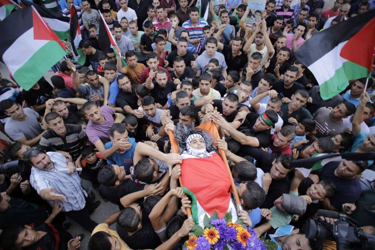 Mourners carry the body of Palestinian boy Bahaa Badr, 13, who was killed by Israeli troops during his funeral at the village of Beit Laqiya near the West Bank city of Ramallah October 17. Israeli forces shot and killed a Palestinian boy in a village in the occupied West Bank on Thursday, local medics and residents told Reuters. Bahaa Badr was shot in the chest as Israeli forces entered Beit Liqya near the dividing line with Israel and were pelted with stones by local youths, the sources said.  || PHOTO CREDIT: AMMAR AWAD  - REUTERS