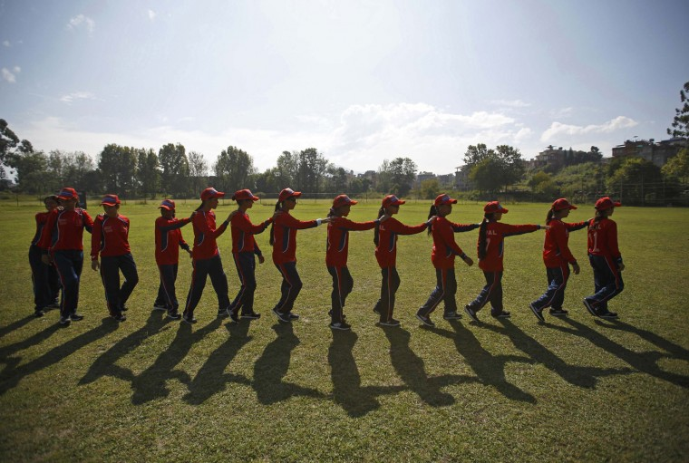 Members of the Nepalese blind cricket team walk on the field before their game at the three-day T20 International Blind Women Cricket Tournament between Nepal and Britain in Lalitpur October 26, 2014. The competition, which is the world's first all-female blind cricket tournament and organized by the Cricket Association of the Blind, Nepal (CAB Nepal), runs from October 26 to October 28. Picture taken October 26, 2014. (Navesh Chitrakar/Reuters)