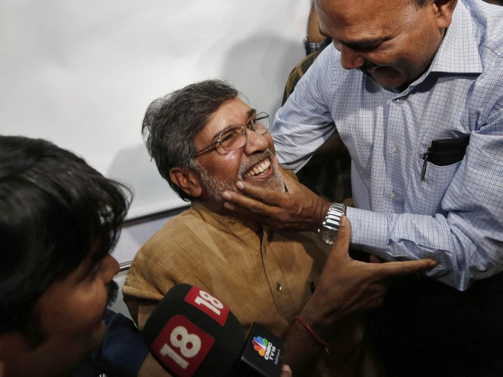 Indian children's right activist Kailash Satyarthi (C) is congratulated by an unidentified man at his office in New Delhi October 10, 2014. Pakistani teenager Malala Yousafzai, who was shot in the head by the Taliban in 2012 for advocating girls' right to education, and Satyarthi won the 2014 Nobel Peace Prize on Friday. Satyarthi, 60, and Yousafzai were picked for their struggle against the oppression of children and young people, and for the right of all children to education, the Norwegian Nobel Committee said. (Adnan Abidi/Reuters)