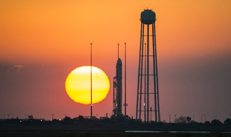 The Orbital Sciences Corporation Antares rocket, with the Cygnus spacecraft onboard, is seen on launch Pad-0A at sunrise at NASA's Wallops Flight Facility, Virginia, in this file photo taken October 26, 2014. The unmanned Antares rocket exploded seconds after liftoff from a commercial launch pad in Virginia on Tuesday, a NASA TV broadcast showed, but space agency officials said there were no injuries. (NASA)