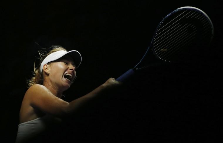 Maria Sharapova of Russia hits a return to Caroline Wozniacki of Denmark during their WTA Finals singles tennis match at the Singapore Indoor Stadium October 21, 2014. (REUTERS/Edgar Su)