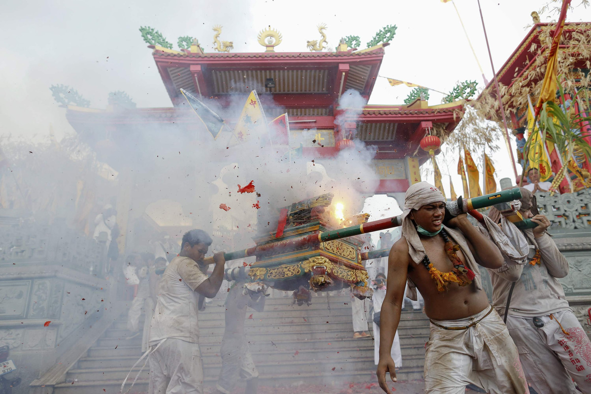 Extreme piercing, hot coal walking and spirit trances are staples of Thailand's Vegetarian Festival  [GRAPHIC CONTENT]