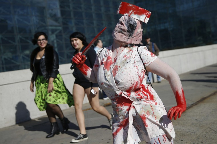 """Ashlee Mantione, dressed as the """"Dark Nurse"""" from the """"Silent Hill 2"""" video game, poses for a photograph at New York's Comic-Con convention October 9, 2014. The event draws thousands of costumed fans, panels of pop culture luminaries and features a sprawling floor of vendors in a space equivalent to more than three football fields at the Javits Center. Shannon Stapleton/Reuters photo"""