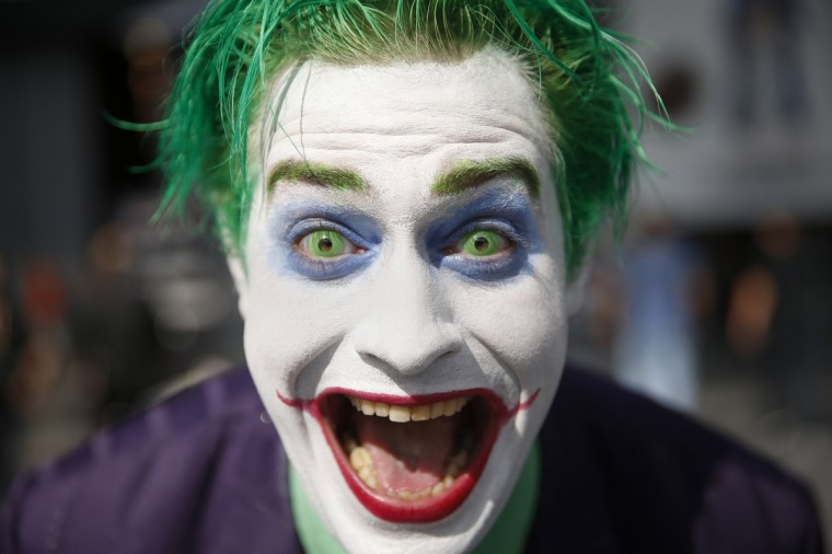 "Trevor Olson, from Minnesota, dressed as the character ""Joker"", poses for a photograph at New York's Comic-Con convention October 9, 2014. The event draws thousands of costumed fans, panels of pop culture luminaries and features a sprawling floor of vendors in a space equivalent to more than three football fields in Javits Center. Shannon Stapleton/Reuters photo"