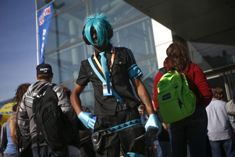 "Kyle Thomas-Franklin, dressed as a character from virtual idol ""Hatsune Miku "", stands outside the New York's Comic-Con convention October 9, 2014. The event draws thousands of costumed fans, panels of pop culture luminaries and features a sprawling floor of vendors in a space equivalent to more than three football fields in Javits Center. Shannon Stapleton/Reuters photo"