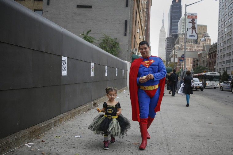 Jonathan Perez and his daughter Sandra McKenzie walk in costume to New York's Comic-Con convention. Shannon Stapleton/Reuters photo