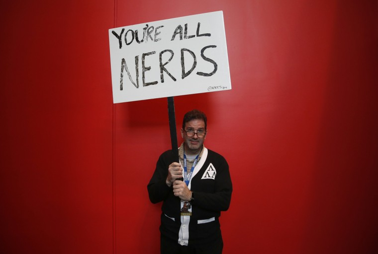 Brad Trechak, from New Jersey, holds a sign inside New York's Comic-Con convention October 9, 2014. The event draws thousands of costumed fans, panels of pop culture luminaries and features a sprawling floor of vendors in a space equivalent to more than three football fields in Javits Center. Shannon Stapleton/Reuters photo