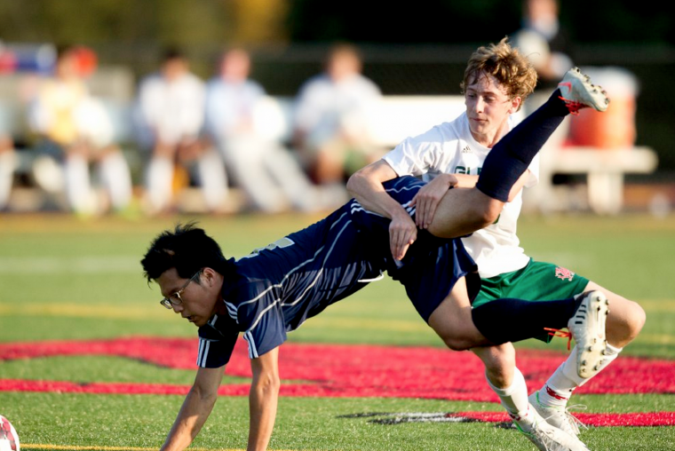 Glenelg Country School's Griffin Keane, right, fouls Chapelgate's Jun Lee during the boys soccer game at Glenelg Country School. (Jen Rynda/BSMG)