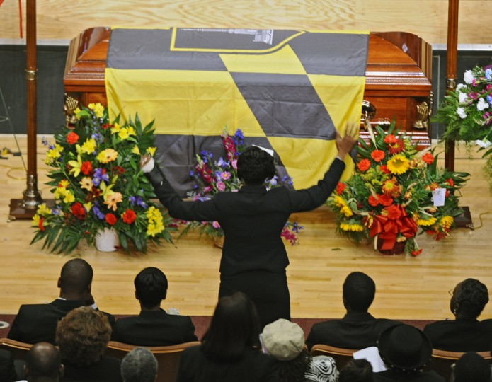 Funeral services were held for former Baltimore City Councilman Kenneth H. Harris, Sr., who was killed during a robbery. Harris' widow Annette Harris, center, is overcome with emotion during memorial service at Morgan State University's Murphy Fine Arts Center in September 2008. (Kenneth K. Lam/Baltimore Sun)