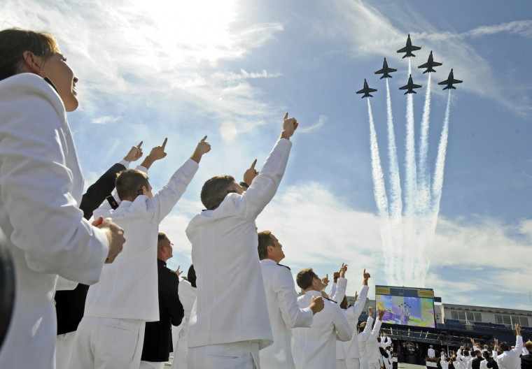 Naval Academy graduates cheer as the Blue Angels make a fly by pass the Navy Marine Corps Stadium. President Barack Obama gave the graduation address to the Class of 2009. (Kenneth K. Lam/Baltimore Sun)