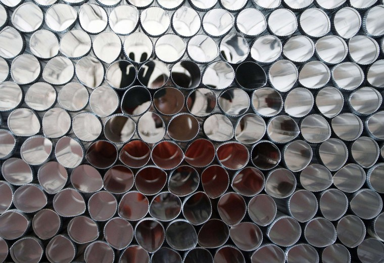 A man arranges metal tubes that are part of a Sobia, a diesel heater, prior to winter season in Sidon, south Lebanon. (Ali HashishoReuters)