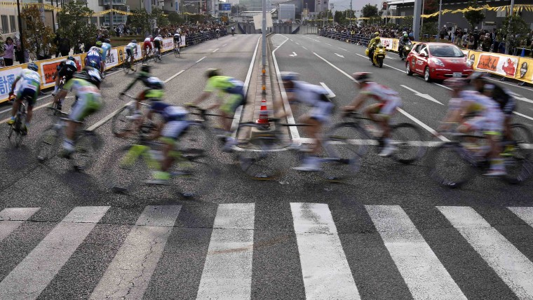 Riders turn a corner during Point Race 2 at the Tour de France Saitama Criterium race in Saitama, north of Tokyo. (Yuya Shino/Reuters)