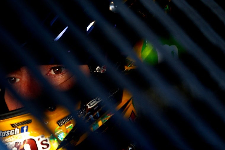 Kyle Busch, driver of the #18 M&M's Halloween Toyota, sits in his car in the garage area during practice for the NASCAR Sprint Cup Series Goody's Headache Relief Shot 500 at Martinsville Speedway in Martinsville, Virginia. (Jeff Zelevansky/Getty Images)