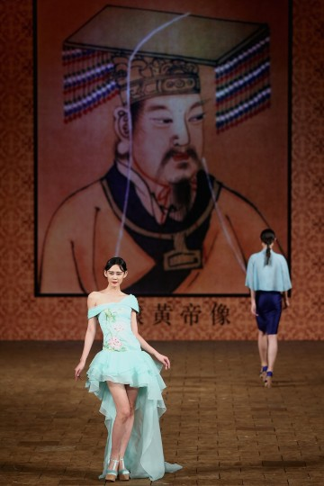 A model showcases designs by Zhang Zhifeng on the runway at 2015 NE-TIGER Haute Couture Collection show during Mercedes-Benz China Fashion Week Spring/Summer 2015 at Beijing Hotel in Beijing, China. (Feng Li/Getty Images)
