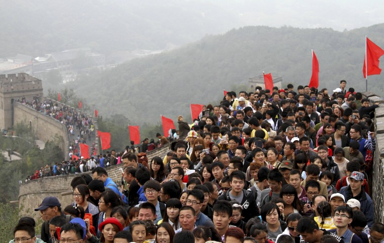 """Tourists visit the Great Wall on the third day of the seven-day national day holiday, on the outskirts of Beijing, October 3, 2014. The national day holiday, known by many Chinese as """"the Golden Week"""" for travel, started on October 1 this year, celebrating the 65th anniversary of the founding of the People's Republic of China. According to a prediction by the China Tourism Academy, a total of 480 million trips are expected to be made by travelers within these seven days, Xinhua News Agency reported. (China Stringer Network/Reuters)"""