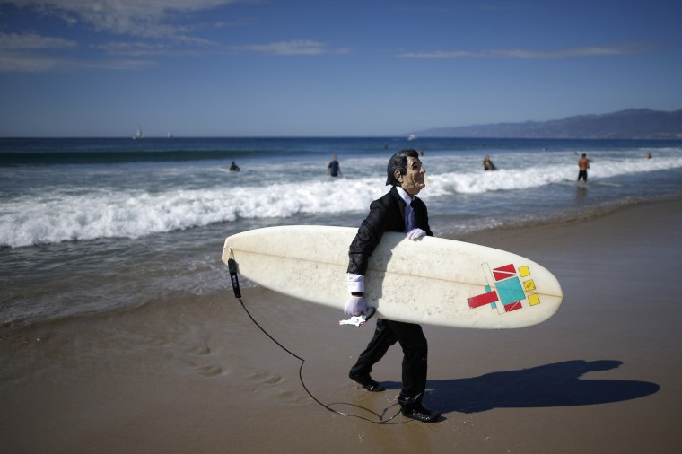 JohnPaul Trotter, 31, walks out of the ocean dressed as President Ronald Reagan after competing in the 7th annual ZJ Boarding House Haunted Heats Halloween surf contest in Santa Monica, California. (Lucy Nicholson/Reuters)