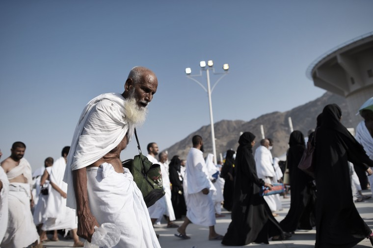 """Muslim pilgrims arrive to throw pebbles at pillars during the """"Jamarat"""" ritual, the stoning of Satan, in Mina near the holy city of Mecca. Pilgrims pelt pillars symbolizing the devil with pebbles to show their defiance on the third day of the hajj as Muslims worldwide mark the Eid al-Adha or the Feast of the Sacrifice, marking the end of the hajj pilgrimage to Mecca and commemorating Abraham's willingness to sacrifice his son Ismail on God's command in the holy city of Mecca. (Mohammed Al-Shaikh/AFP-Getty Images)"""