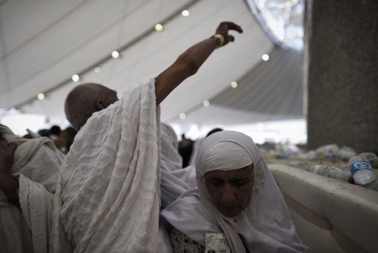 """Muslim pilgrims throw pebbles at pillars during the """"Jamarat"""" ritual, the stoning of Satan, in Mina near the holy city of Mecca. Pilgrims pelt pillars symbolizing the devil with pebbles to show their defiance on the third day of the hajj as Muslims worldwide mark the Eid al-Adha or the Feast of the Sacrifice, marking the end of the hajj pilgrimage to Mecca and commemorating Abraham's willingness to sacrifice his son Ismail on God's command in the holy city of Mecca. (Mohammed Al-Shaikh/AFP-Getty Images)"""