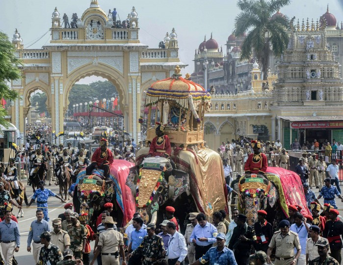 """The royal elephant of the Mysore Palace carries the Golden Howdah containing Hindu Goddess Chamundeshwari during Vijayadashami celebrations in Mysore. Vijayadashami marks the end of """"Navrathri"""" the nine-night Dasara festival celebrations in the country. (Stringer/AFP-Getty Images)"""
