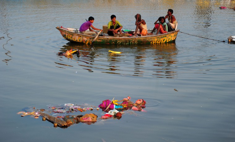 An idol of the Hindu goddess Durga floats in a temporary pond near Sangam after immersion in Allahabad. The Durga Puja festival commemorates the slaying of a demon king Mahishasur by goddess Durga, marking the triumph of good over evil. ( Sanjay Kanojia/AFP-Getty Images)