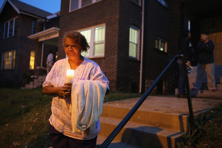 The grandmother of 18-year-old Vonderrit Myers Jr. stands near the spot where he was killed during a candlelight vigil on October 9, 2014 in St Louis, Missouri. Meyers was shot and killed yesterday by an off duty St. Louis police officer. The St. Louis area has been struggling to heal since riots erupted in suburban Ferguson, Missouri after the shooting death of 18-year-old Michael Brown by a Ferguson police officer on August 9. (Photo by Scott Olson/Getty Images)