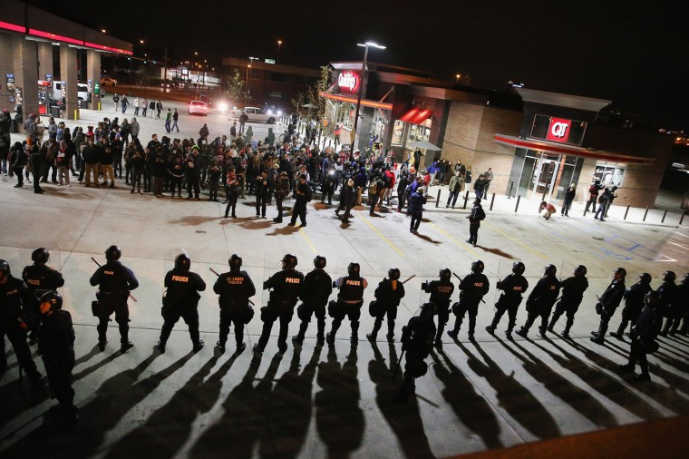 Demonstrators protesting the killings of 18-year-olds Michael Brown by a Ferguson, Missouri Police officer and Vonderrit Myers Jr. by an off duty St. Louis police officer are confronted by police wearing riot gear on October 12, 2014 in St Louis, Missouri. The St. Louis area has been struggling to heal since riots erupted in suburban Ferguson following Brown's death. (Photo by Scott Olson/Getty Images)