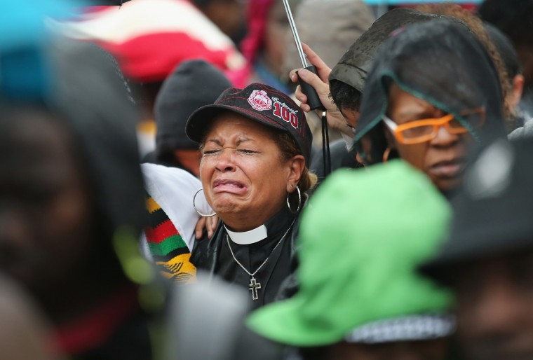 A member of the clergy sobs during a prayer calling for an end to racial injustice during a protest outside the Ferguson police station on October 13, 2014 in Ferguson, Missouri. Ferguson has been struggling to heal since riots erupted following the August 9 killing of 18-year-old Michael Brown by a police officer in suburban Ferguson. Another teenager, Vonderrit Myers Jr., was killed by a St. Louis police officer on October 8. Several demonstrators and members of the clergy were arrested at the protest after a show of civil disobedience. (Photo by Scott Olson/Getty Images)