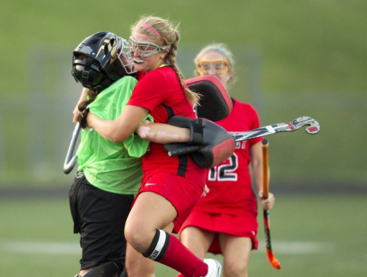 Dulaney goalie Kalie Paranzino, left, celebrates their goal in the second half of the field hockey game with teammate Megan Wienhold against Catonsville. (Jen Rynda/BSMG)
