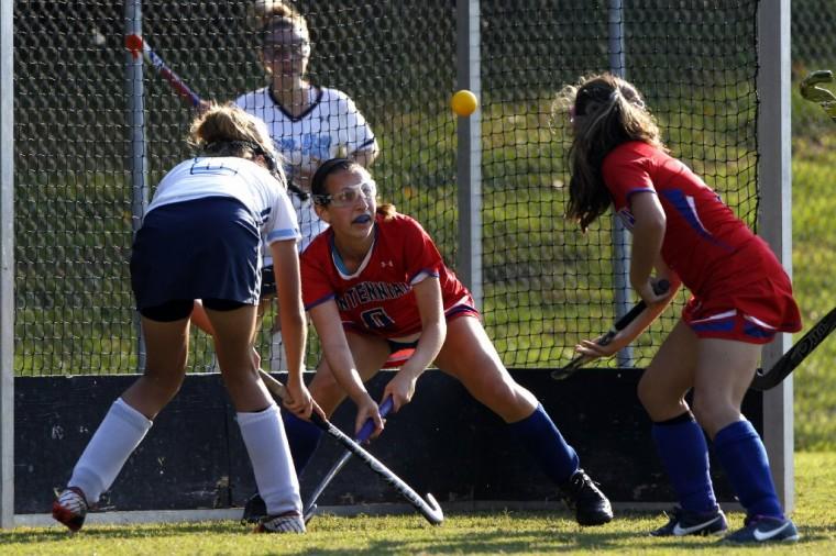 Centennial's Mary Monroe defends the net during a girls field hockey game at River Hill High School. (Matt Hazlett/BSMG)