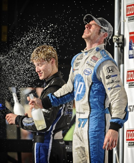 Simon Pagenaud, right, winner of the 2013 Grand Prix of Baltimore, celebrates with sparkling wine at the winner's circle. (Kenneth K. Lam/Baltimore Sun)